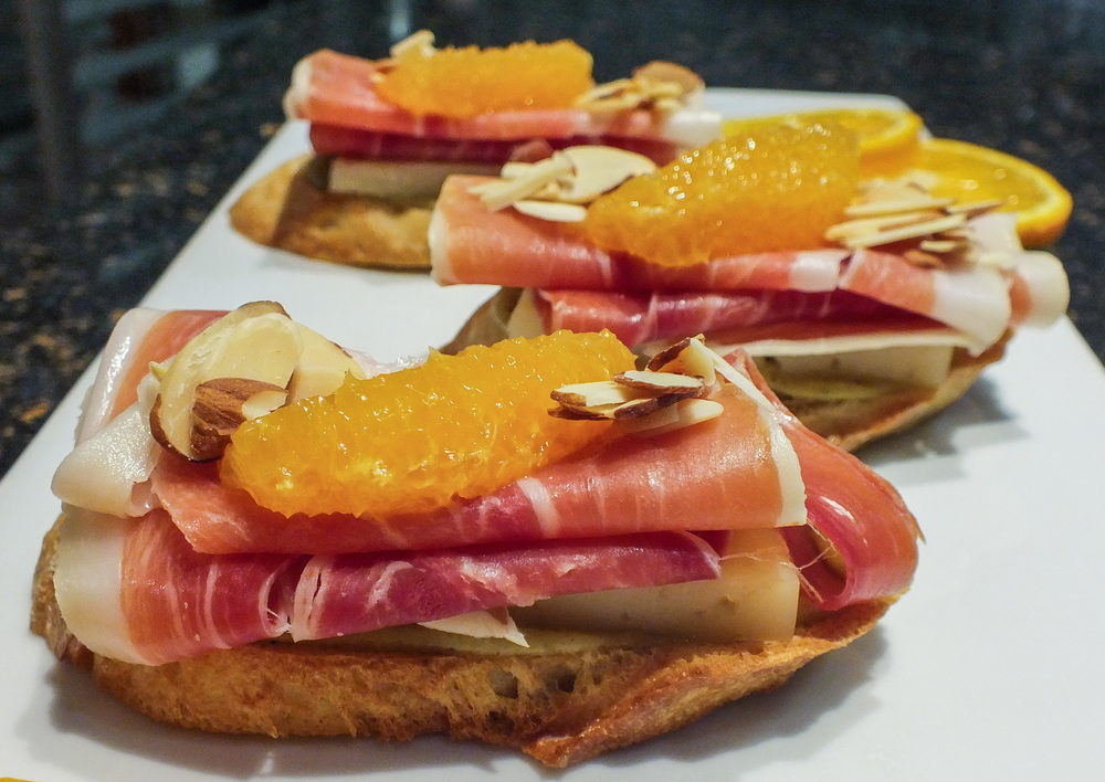 Serrano ham, green olive tapenade, orange supremes, Spanish manchego cheese, sea-salted shaved almonds