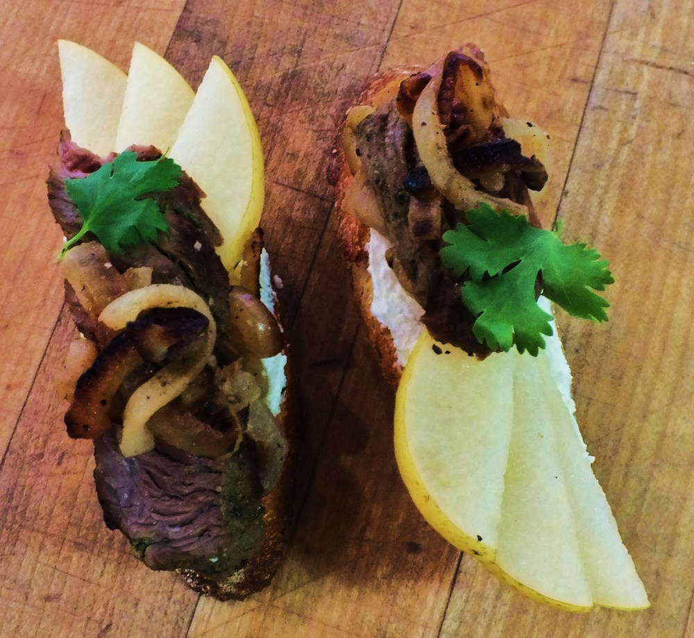 Flank steak, caramelized onions, Asian pear slices, and Roquefort butter spread