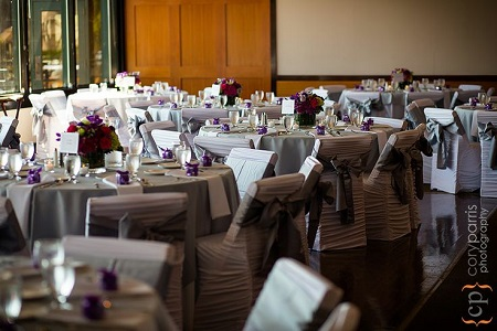 Decor should be used simply as an accent to a space, not to cover a space. These chair covers, color scheme, and florals are the perfect touches.