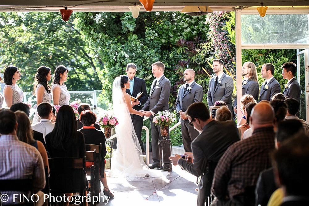outdoor wedding ceremony along the water