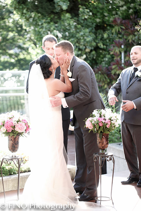 summer outdoor ceremony first kiss