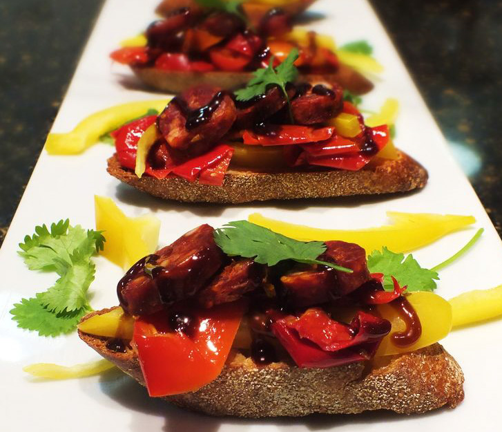 Paprika-spiced Spanish chorizo, smoke roasted red and yellow peppers, dark chocolate demi-glace