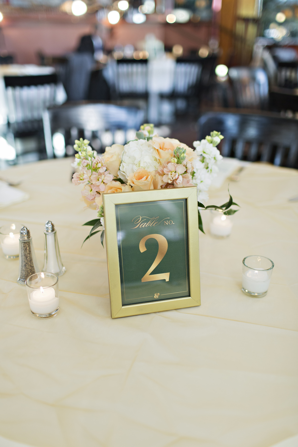 Gold and emerald table numbers