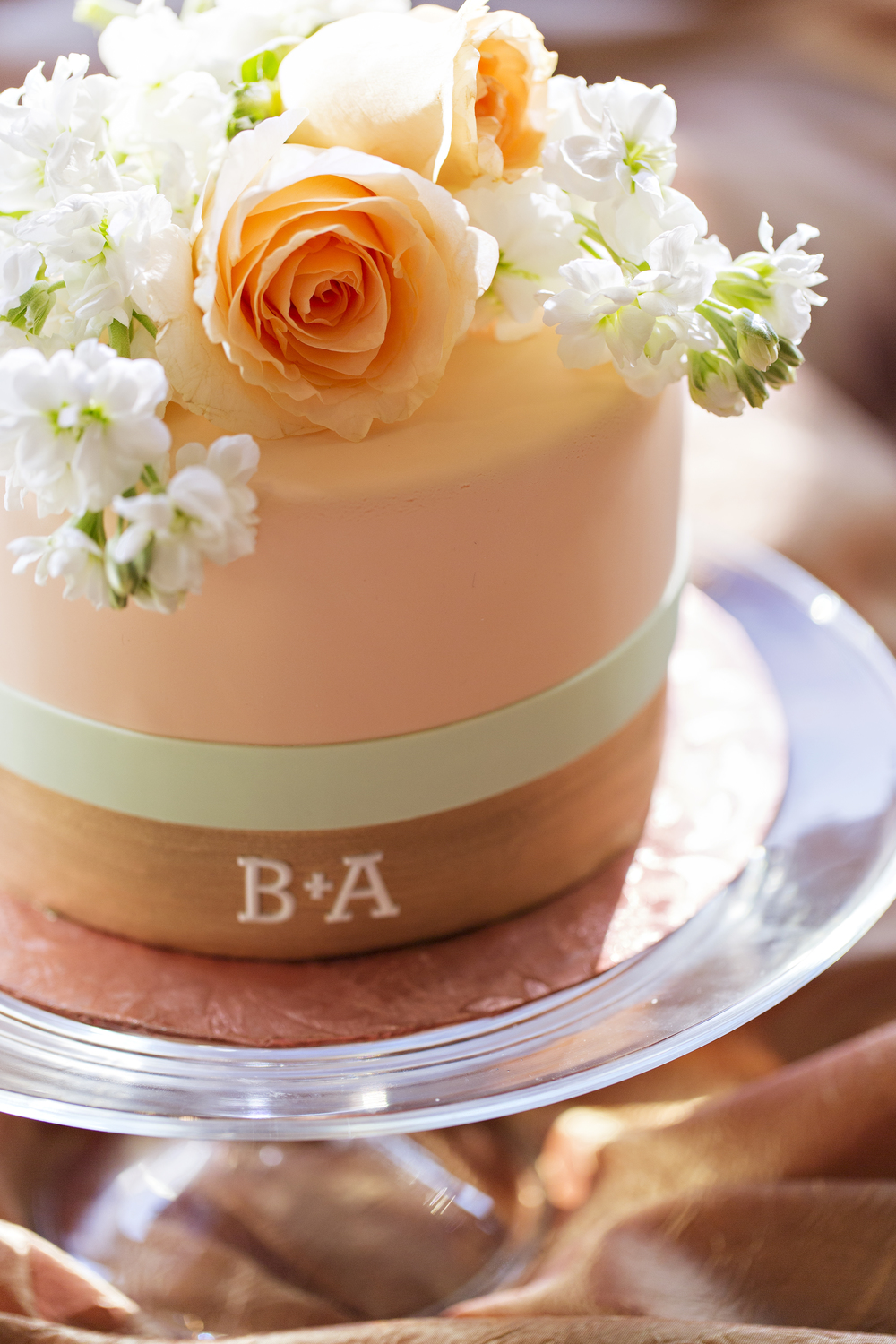 Peach, mint, and gold wedding cake