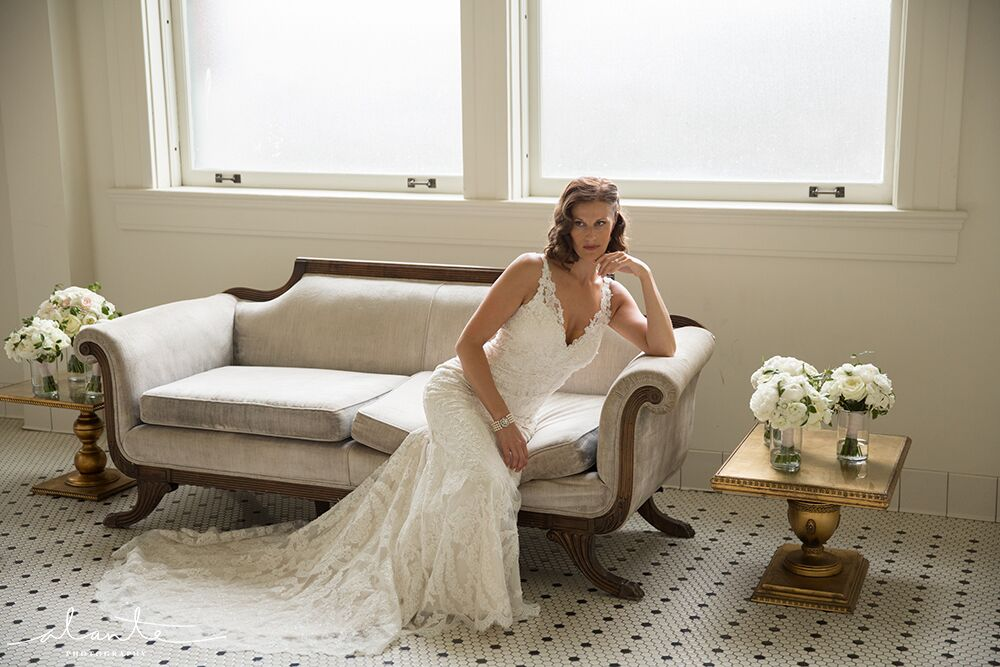 Bride on vintage white and gold furniture