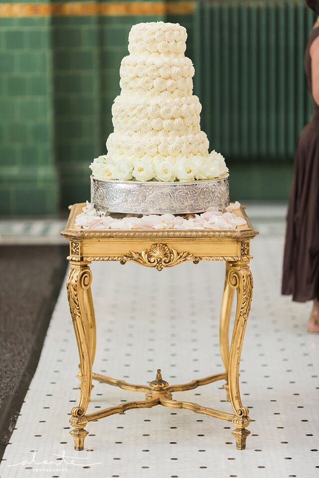 Beautiful rosette wedding cake on a vintage cake stand