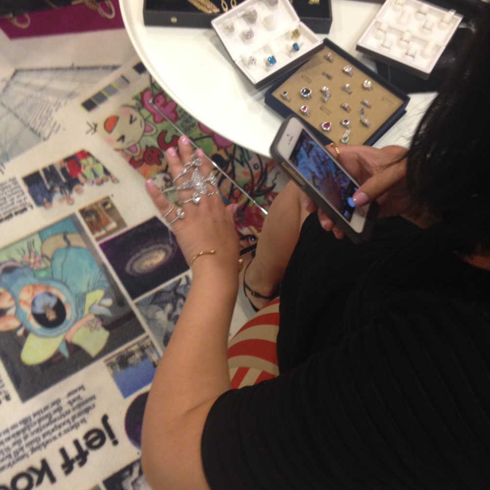 The lovely Tina Huynh, jewelry assistant editor of W Magazine, snapping some pictures of her favorite jewelry pieces.