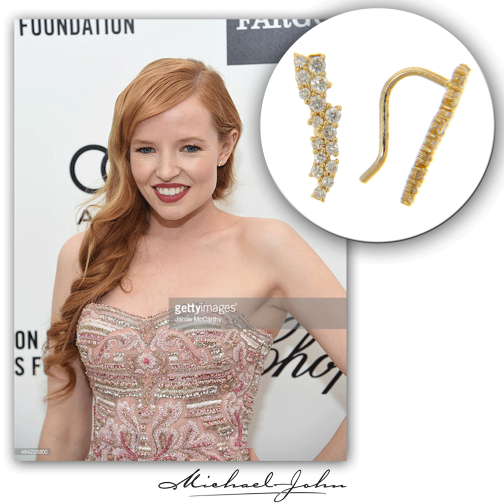 Styling the red carpet pretty, Stef Dawson is all smiles for the camera in her Michael John Jewelry diamond earrings.