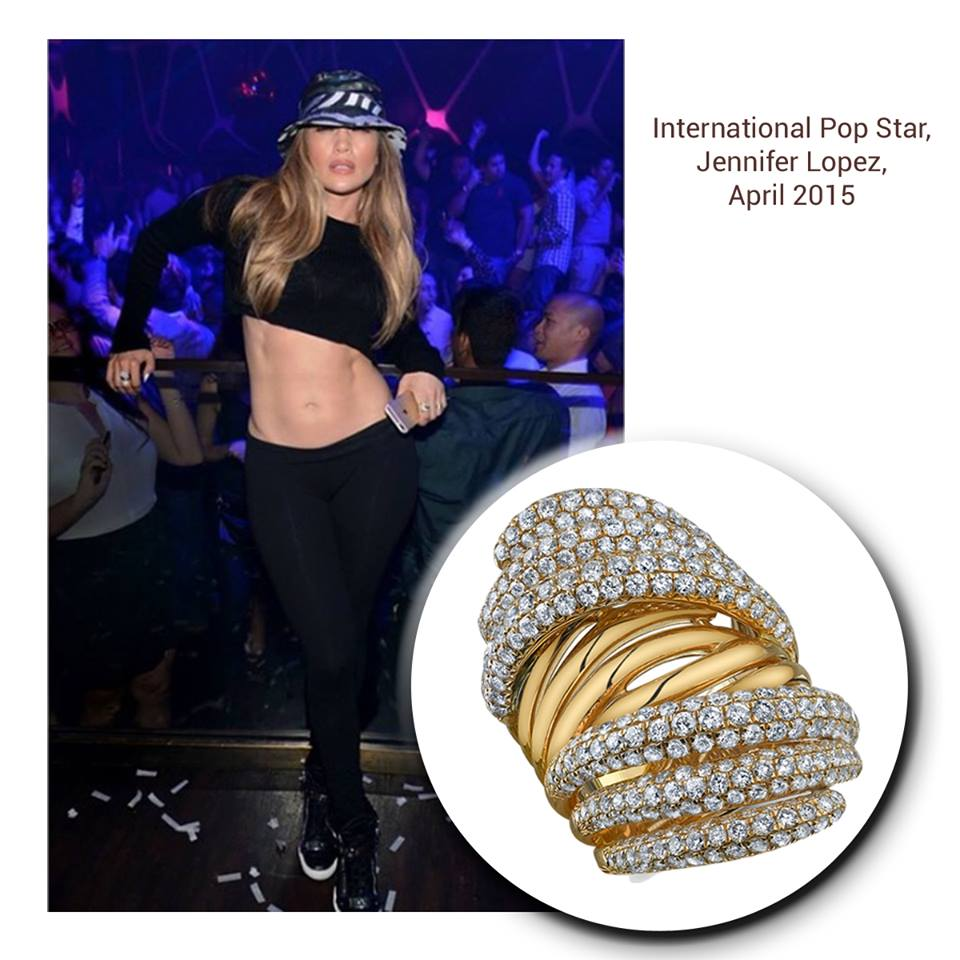 """Fit and fabulous, nobody rocks the """"J-Lo"""" ring like international star, J-Lo, herself! We absolutely adore her in this glamorous Sylvie Collectionyellow gold fashion ring, sprinkled with diamonds all around!"""