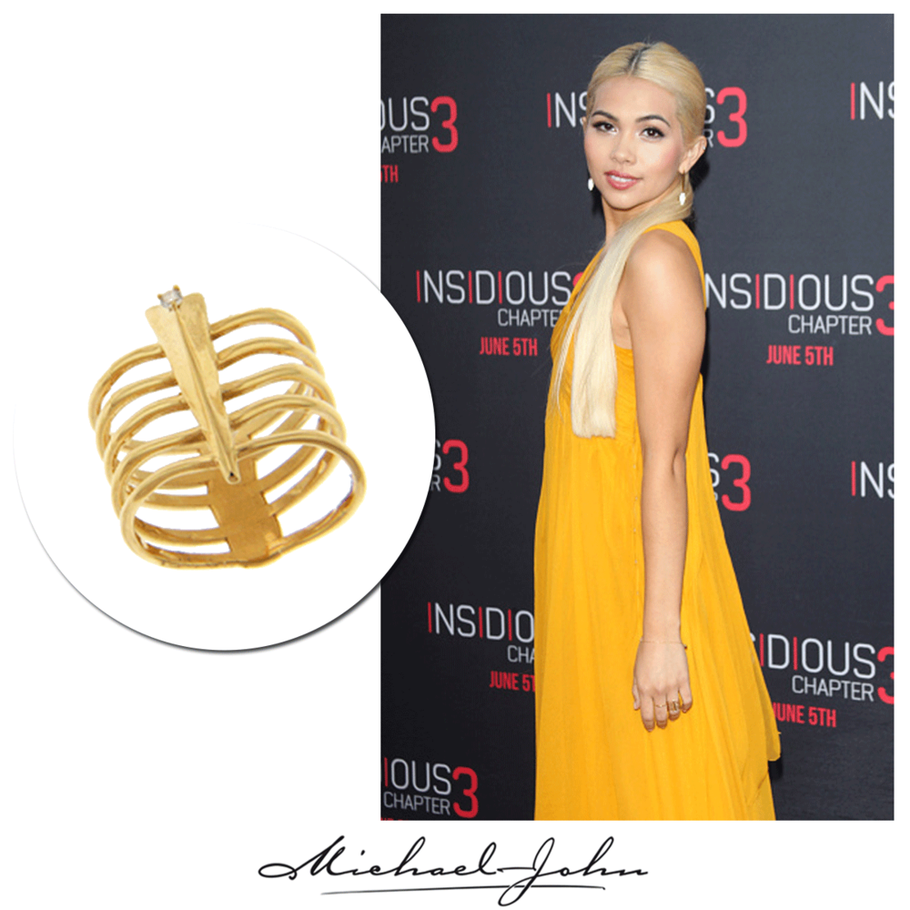 As bright as the shining summer sun! Hayley Kiyoko gleams on the red carpet in a long orange dress + simple, yet trendy openly-spaced yellow gold ring, brought to you by Michael John Jewelry!