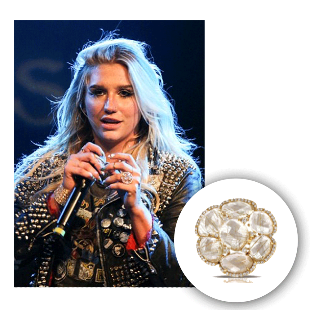 Not only does Kesha have a lovely voice, she loves to look beautiful while showcasing it! Check her out in this flower-inspired yellow gold and diamond Marco Moore fashion ring!