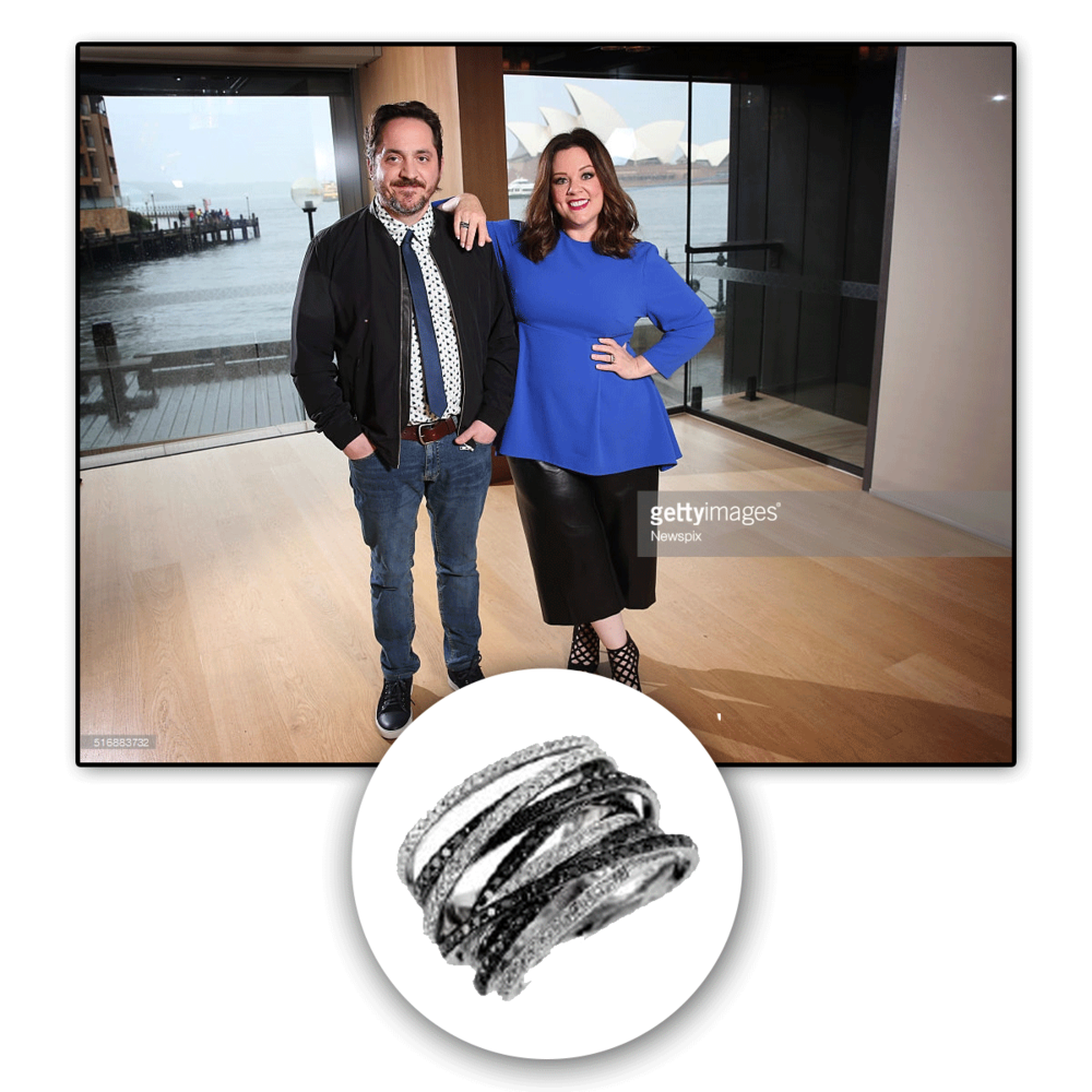 Melissa McCarthy looks absolutely dazzling in this intertwined white gold and black diamond Royal Jewelry fashion ring.