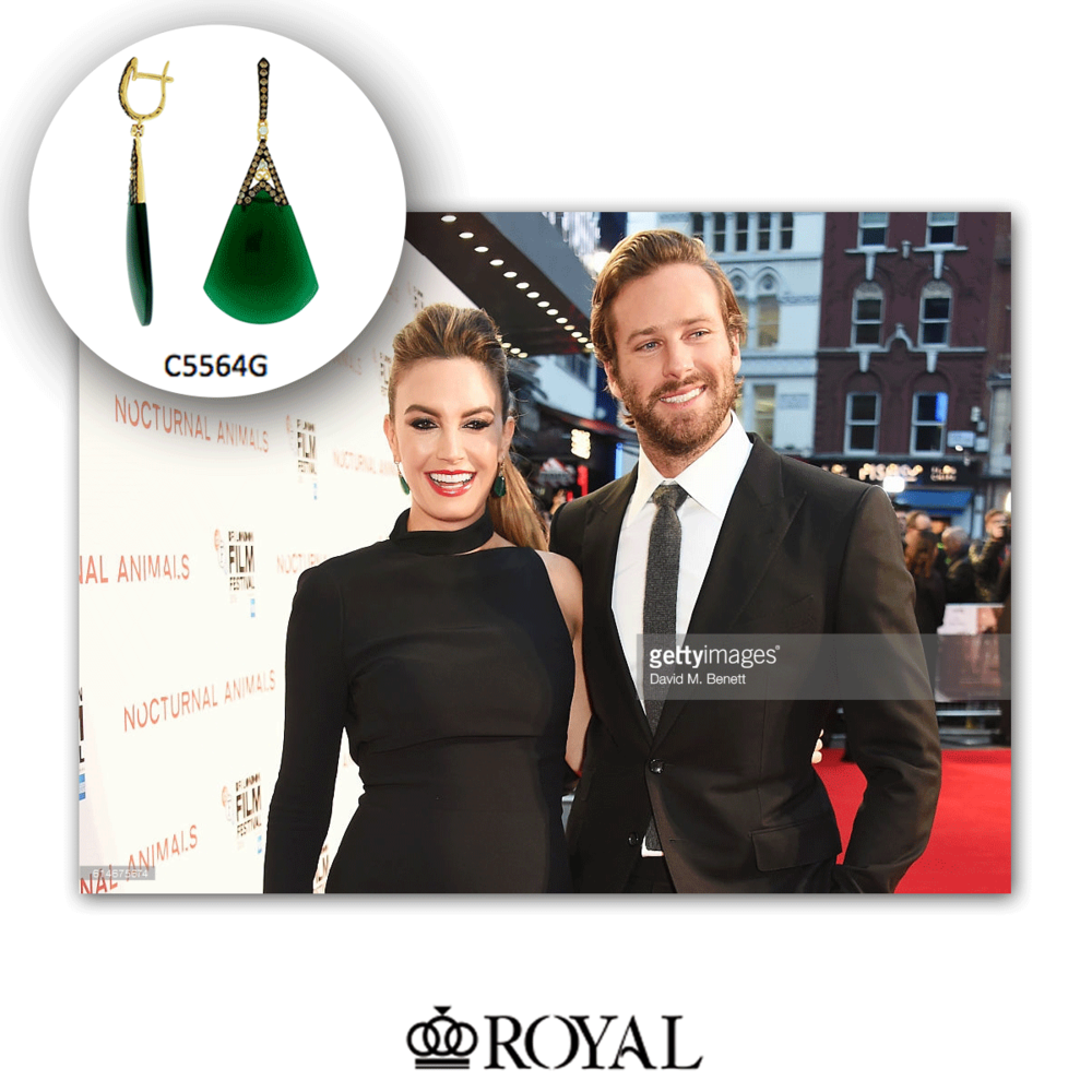 A beautiful couple deserves beautiful accessories, right? These green agate earrings from Royal Jewelry compliment Elizabeth's sleek look so well!
