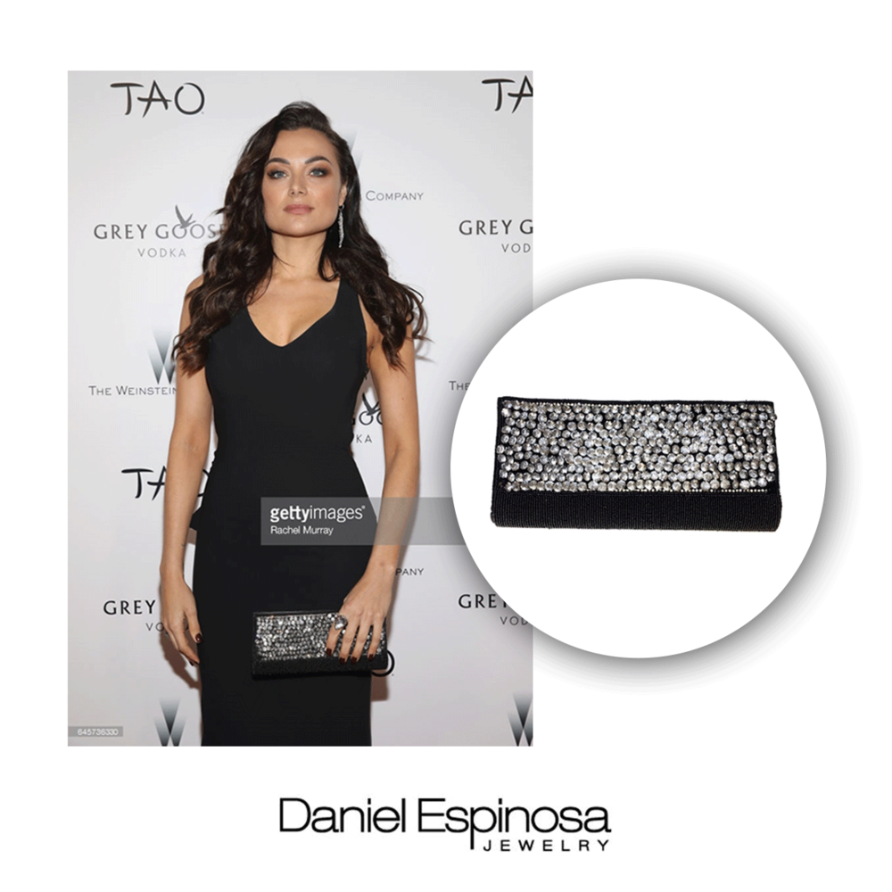 To complete Christina's look, she rocks a glitzy clutch from Daniel Espinosa.