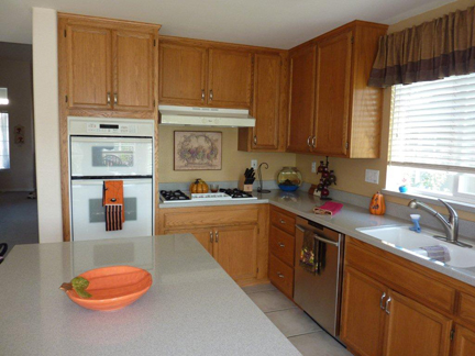 light oak cabinets before.jpg