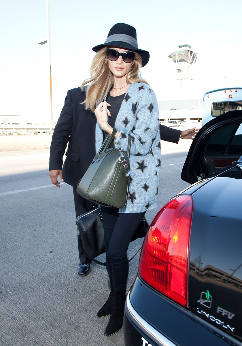 Rag & Bone hat, Chanel glasses, Balenciaga bag, Givenchy bag, Saint Laurent jacket, Balmain boots   Los Angeles International Airport, November 2013
