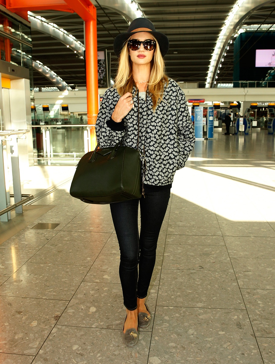 Givenchy bag, Stella McCartney jacket, Janessa Leone hat, Aquazzura shoes, Fendi sunglasses, Frame jeans   London Heathrow Airport, March 2014