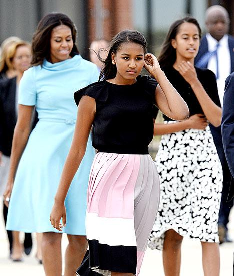 And her little ladies looked no less chic! Malia, 17, who recently completed an internship on the set of HBO's Girls, worked a black and white dress with a floral skirt, teamed with sky-blue Mary Janes. Her younger sister, Sasha, 14, chose a black top with pleated cap sleeves, paired with a color-blocked Kate Spade skirt and ballerina flats. Of course, the Obama ladies were joined by the president, Barack Obama, who looked dapper in a navy-blue suit, a white button-up, a cornflower-blue tie, and lace-up shoes.