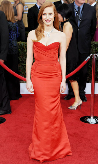 """Credit: Gregg DeGuire/WireImage.com   """"I love Alexander McQueen!"""" Jessica Chastain told  Us of the dress she paired with $1.25 million of Harry Winston jewels at the 2013 SAGs.  Read more: http://www.usmagazine.com/celebrity-style/pictures/hollywoods-hottest-fashion-designers-2013192/28599#ixzz3mlrdykmO"""