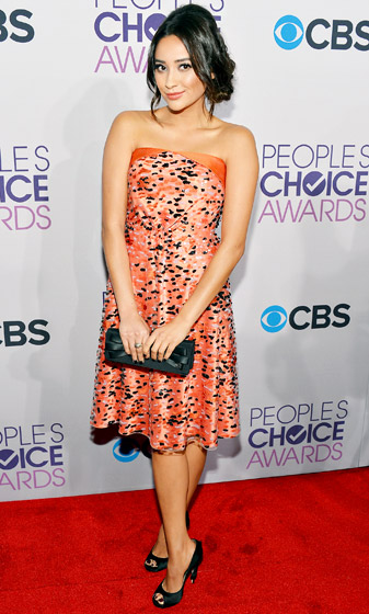 Credit: Frazer Harrison/Getty   Shay Mitchell looked uberfeminine in a Giorgio Armani dress at the 2013 People's Choice Awards. Read more:  http://www.usmagazine.com/celebrity-style/pictures/hollywoods-hottest-fashion-designers-2013192/28607#ixzz3mlxWlz5M