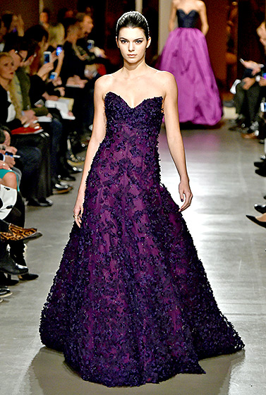 Credit: Slaven Vlasic/Getty Images   Purple princess! Walking in the first ODLR show since the designer's passing (now headed by Peter Copping), Jenner embodied elegance in an embellished eggplant ball gown in the Big Apple on Feb. 17.