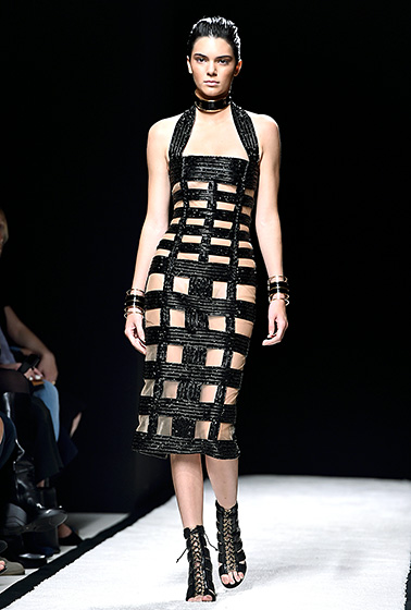Credit: Pascal Le Segretain/Getty Images   Doesn't get any hotter than this! Jenner sizzled in a black Balmain dress with boxy cutouts in Paris on Sept. 25.