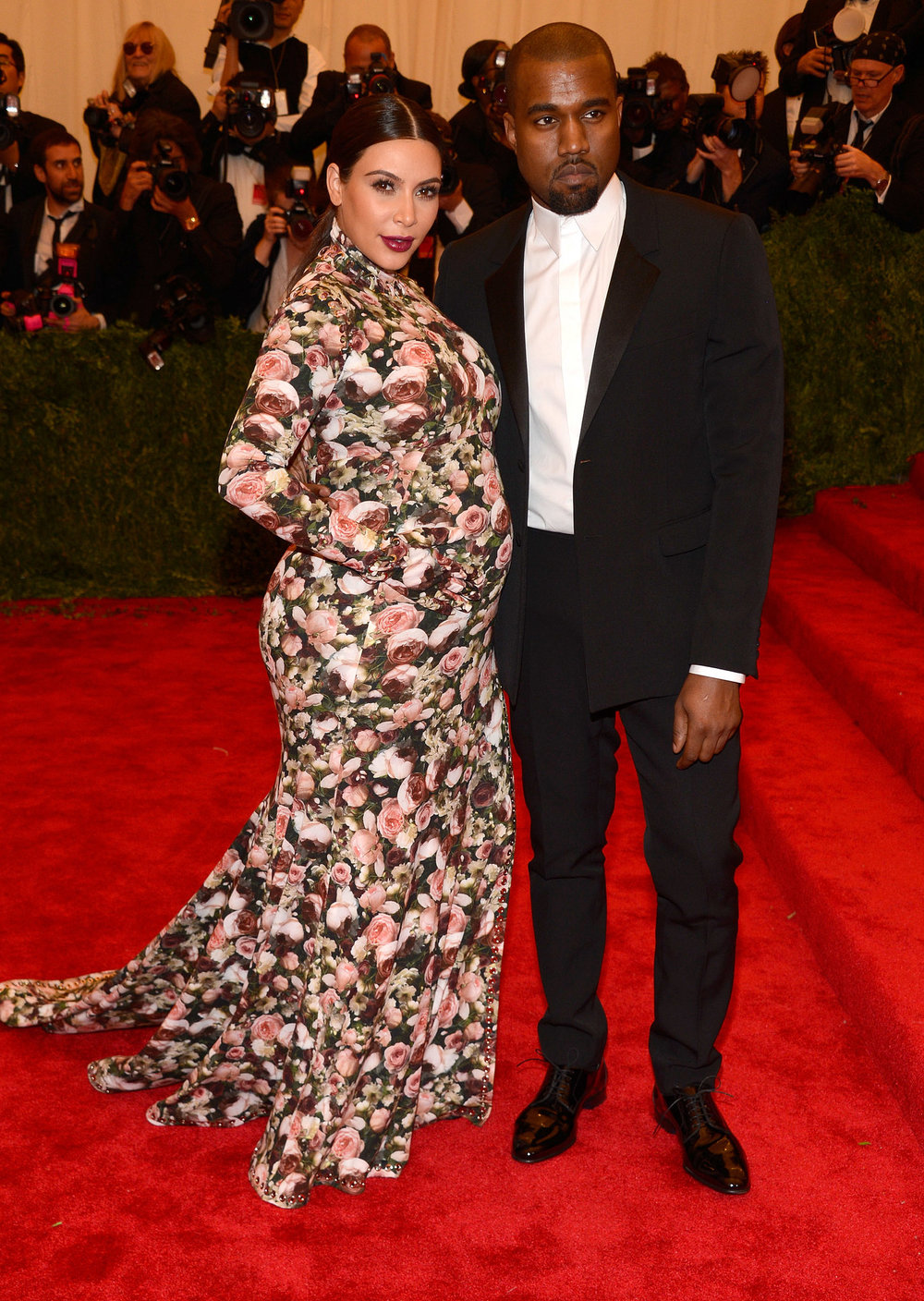 Image Source: Getty / Kevin Mazur Kim Kardashian The then Mom-to-be Kim Kardashian's floral Givenchy by Riccardo Tisci gown will likely go down in history as one of the most talked-about maternity looks of all time. Her custom look for the 2013 Met Gala featured gloved long sleeves and a thigh-high slit.