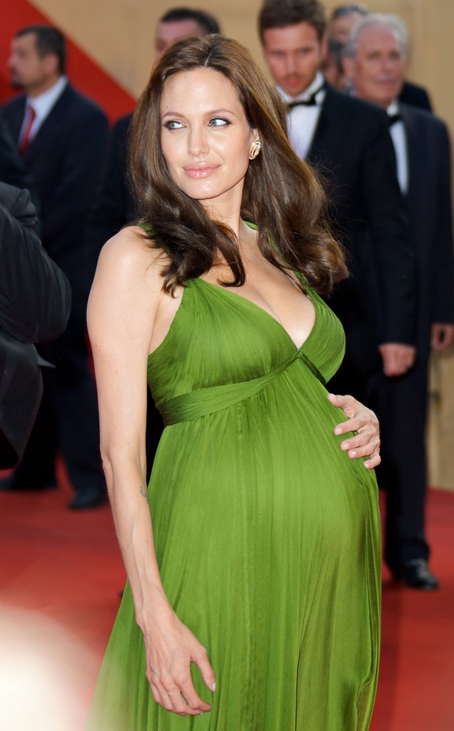 Image Source: Getty / Mike Marsland Angelina Jolie Show It's Easy to Be Green For the Cannes premiere of Kung Fu Panda, Angelina Jolie stunned in a Grecian-style gown from Azria Atelier. Earlier that week, her costar Jack Black spilled the beans that the megastar was expecting twins.