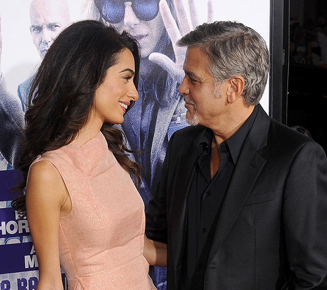 "George Clooney and his wife Amal looked loved up at actor's film premiere George Clooney and his wife Amal looked loved up at actor's film premiere Having recently celebrated their first anniversary, the pair only had eyes for each other as they shared a kiss and held hands at the premiere of Our Brand is Crisis, a dramatic comedy starring Sandra Bullock and produced by George himself. George told People, ""We had a beautiful anniversary, and we're having fun."""