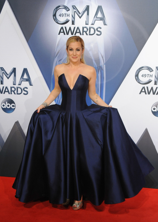 Kellie Pickler in a strapless, navy blue ballgown. Pickler went for a moody princess look, wearing a strapless navy gown with plunging neckline and full ball skirt. The country singer will soon star in her own CMT reality show, aptly titled I Love Kellie Pickler, alongside her husband Kyle Jacob