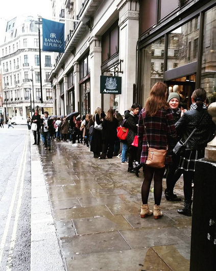 Shoppers braved the rain (and presumably took a day off work/uni) to queue for hours in London this morning. [Photo: Instagram]