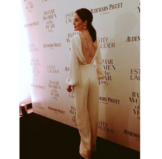 """Downton Abbey"" star Michele Dockery shows off the detail of her Ralph and Russo white jumpsuit. [Photo: Instagram/Harper's Bazaar]"