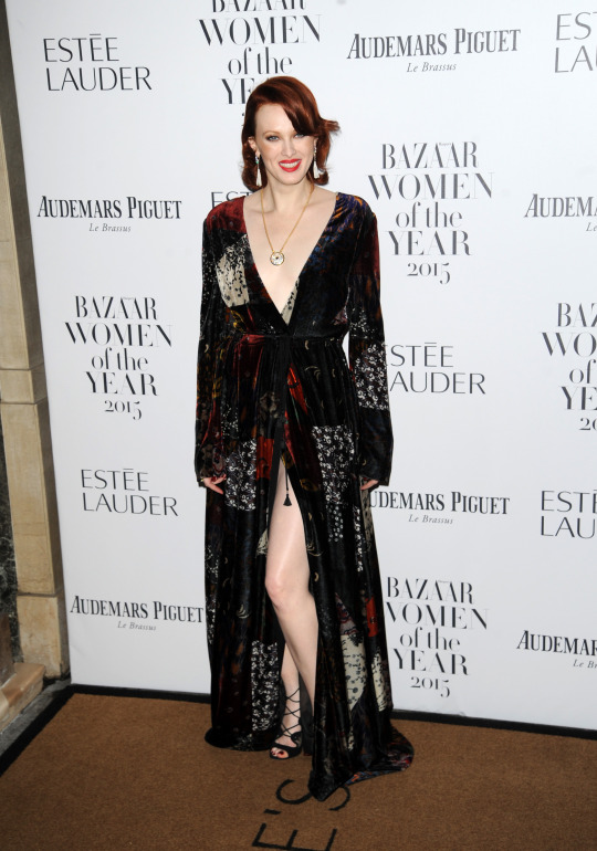 Model Karen Elson was bang on trend in an autumnal print velvet wrap dress.  [Photo: Rex]