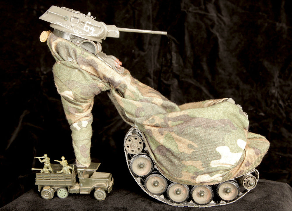 9. The detail that went into this stiletto complete with a full army and tanks deserves an award. It's all your GI Joe/GI Jane fantasies come true, made with vintage camouflage army clothing, and war toys.