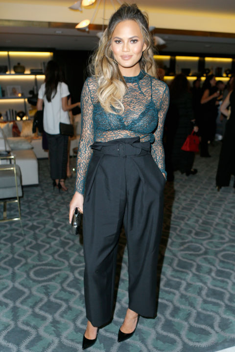 In Stella McCartney high-waisted pants and a see-through lace Femme d'Armes top at The Hollywood Reporter's Beauty Dinner in Los Angeles.  GETTY