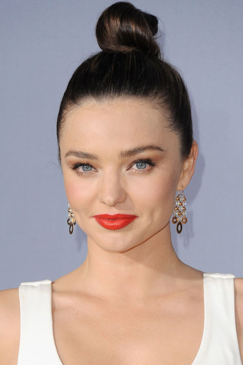 Who: Miranda Kerr  What: A Sky High Knot  How-To: Consider Kerr's beauty look at last night's  InStyle Awards  the answer the next time you're feeling exhausted/dull-skinned/in need of a mini facelift: The high, silky-smooth bun draws attention upwards, making your face look thinner, while red lipstick and gold shadow brighten and wake up your complexion.  Editor's Pick: Tatcha Kyoto Red Silk Lipstick, $55,  tatcha.com .  GETTY