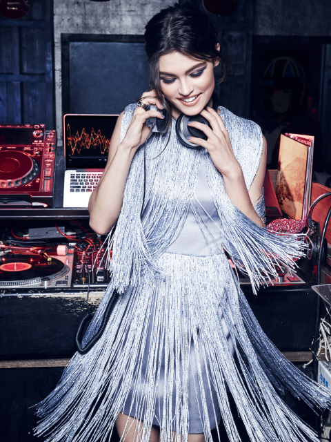 When it's time to turn things up a notch, take charge of the scene in a look that effortlessly blends cocktail party charm with the drama of the dance floor. Hello, metallic fringe.    Play DJ in indigo smoky eyes that give off an iridescent shimmer, big, blown out lashes and glossy nude lips.