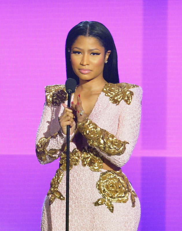 We can always count on Nicki Minaj to make her presence known and the  2015 American Music Awards  were no exception.  For Sunday night's festivities, the louder-than-life rapper stepped out in a pink curve-hugging, cut-out gown with gold embellishments. Overall, she looked pretty elegant -- but slightly more sexy than  the flirty black dress  she donned at last year's show.   And while we're thankful her bizarre costume-attired days are over, Ms. Minaj still knows how to catch our eye -- in a good way.   Here's a look at Nicki's 2015 AMAs ensemble. Let us know what you think in the comments section below.