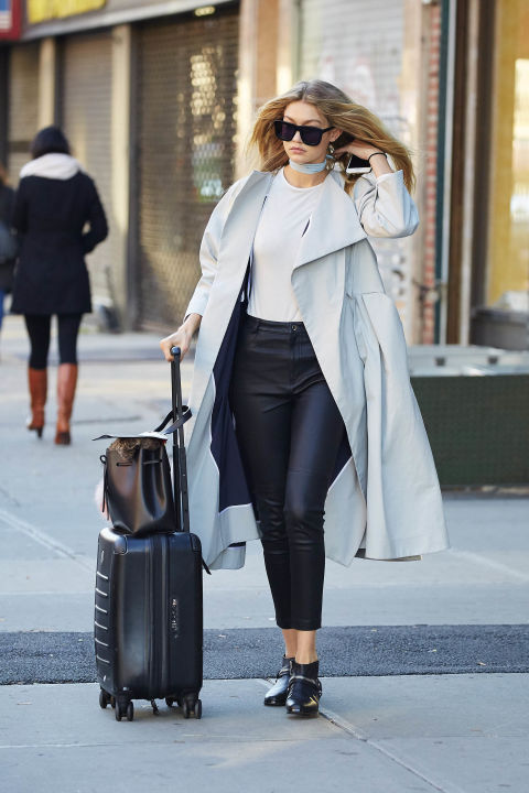 In a Toni Maticevski overcoat, Topshop leather leggings, Solsana Shoes booties and Karen Walker sunglasses while out in NYC.  SPLASH