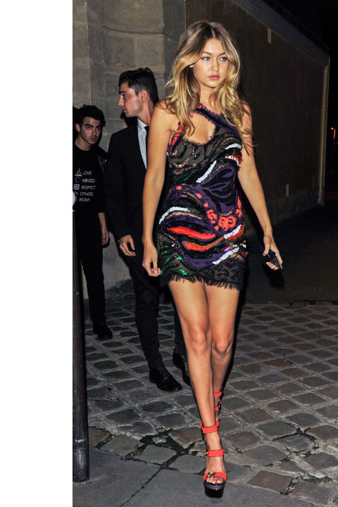 The leggy model hits the party scene at Paris Fashion Week in the exact Versace dress she wore on the runway in Milan.  AKM-GSI