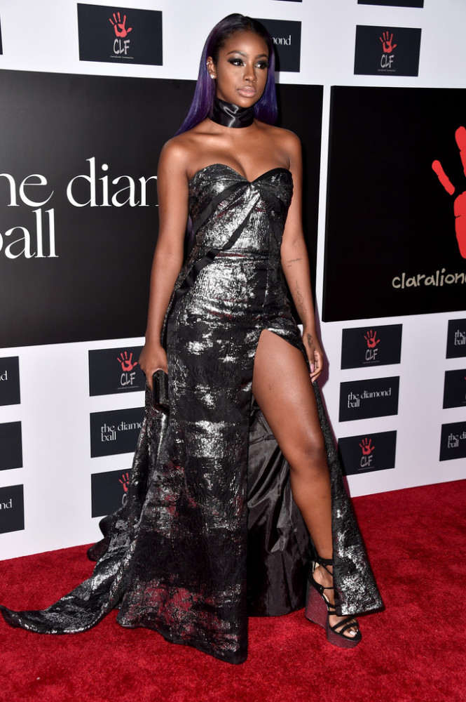 Justine Skye gleamed in a strapless silver, bustier-inspired Rubin Singer gown with a thigh-baring slit.