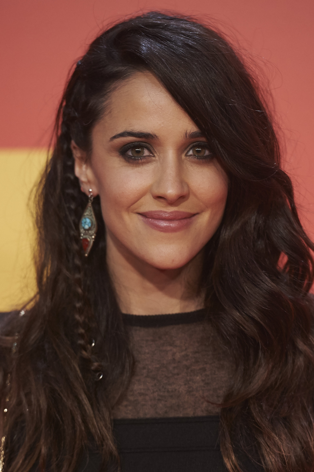 Add one simple braid to the underside of loose waves.  Photo: Getty Images
