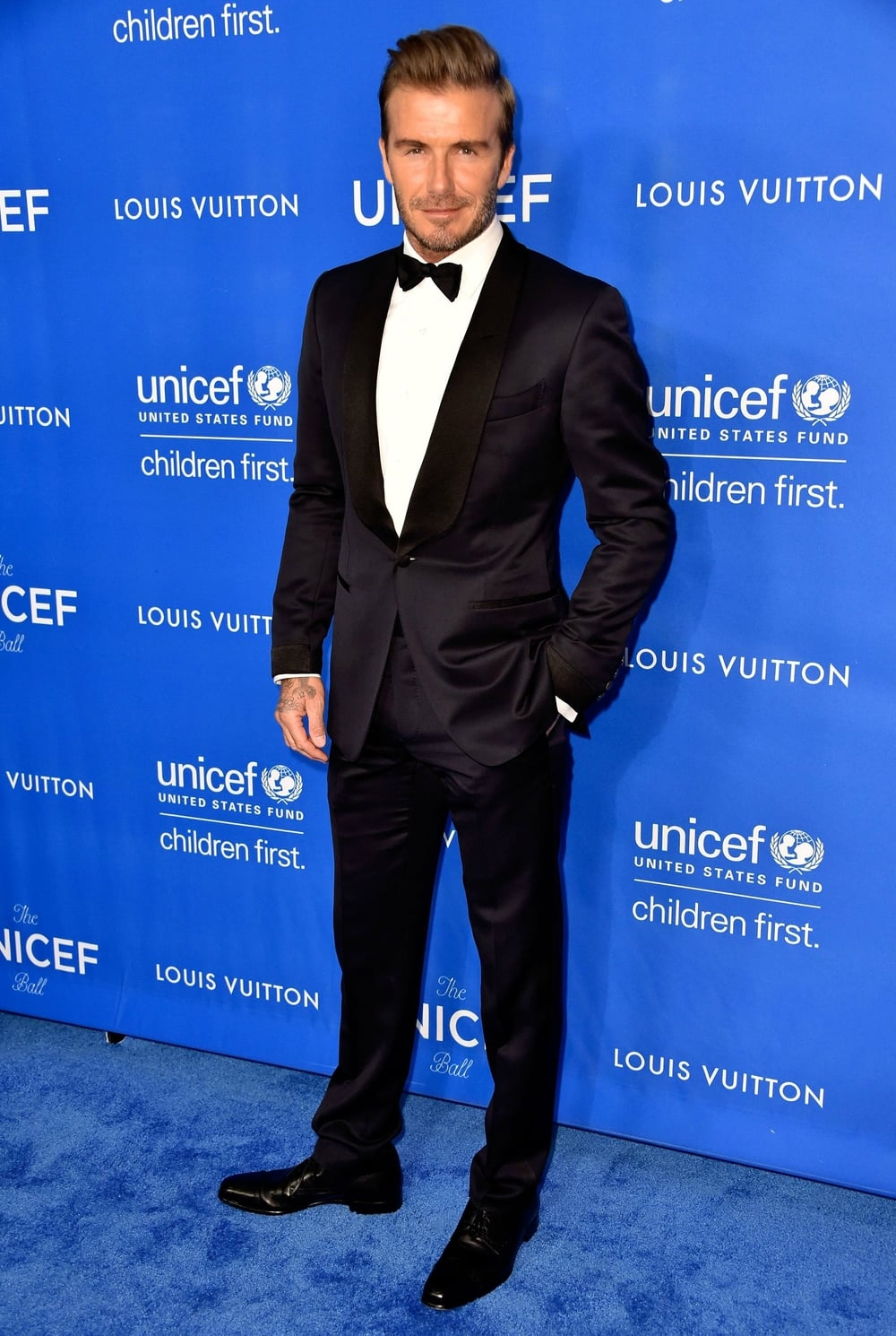 12 January  David Beckham wore a classic black tux and bow-tie to pick up the Humanitarian Award during the evening