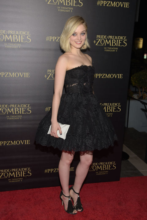 21 January   Bella Heathcote walked the red carpet in a black lace strapless dress and strappy sandals.