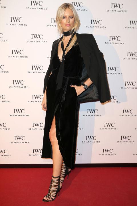 19 January Karolina Kurkova teamed her black wrap dress with a skinny scarf, blazer and strappy Sophia Webster sandals.