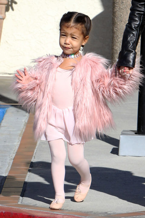 Another day, another chance for North West to dress better than you. The 2-year-old headed to ballet class in a pink fur and diamond  Fallon Jewelry choker , proving she's not your average ballerina tot, she's high  fash-un. If only all of us could look this good at ballet class...  SPLASH