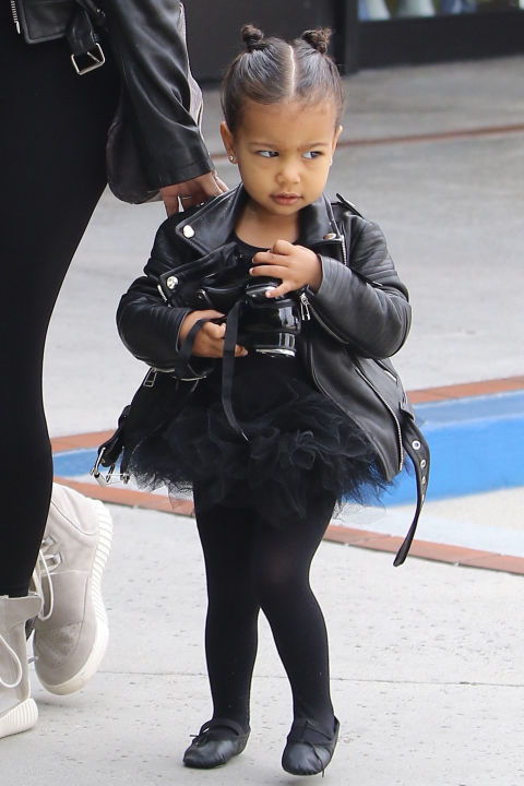 North toughens up her all-black ballet tutu with an edgy leather jacket—and her signature double bun hairstyle.  SPLASH