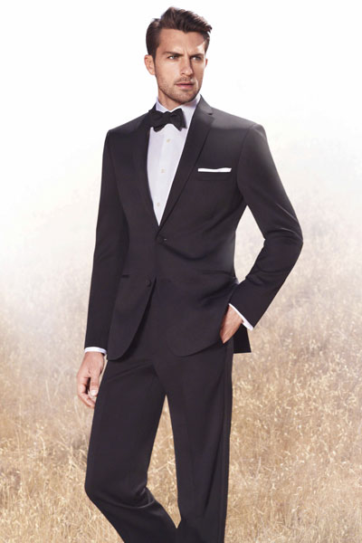 The BLACK by Vera Wang Slim Fit Gray Tuxedo features satin edges on a notch lapel and flat-front trousers with a satin stripe down the leg for a chic alternative to the classic black tuxedo.