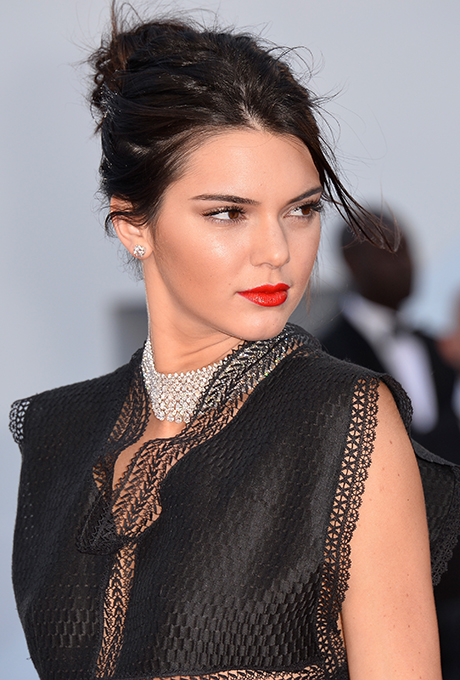 Kendall Jenner  Kendall proves a bold red lip doesn't need much to look killer — just a dab of mascara and loosely pulled back updo will do.