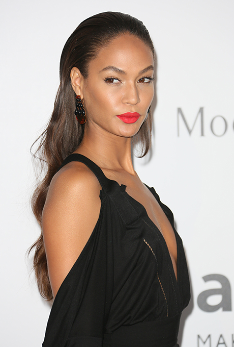 Joan Smalls  It doesn't get sexier than Joan's slicked-back hairstyle, sharp brows, and punchy lip.  Photo: Getty Images